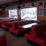 Period red leatherette booths