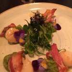 Scallops, pea and mint puree, bacon, pea shoots, crispy seaweed, edible pansies. A very pretty d