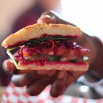Our veggie sandwich with housemade beet hummus & red cabbage slaw on a buttermilk biscuit