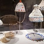 African hats and necklaces made of cowri shells and beads
