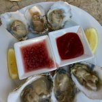 Oysters with both a traditional dipping sauce and a pickled onion drench as well.