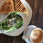 Chicken Pesto panini with cappuccino and side salad.