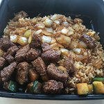 Greasy rice and dry steak