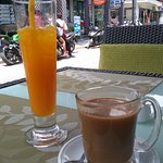 Orange juice and black coffee with milk