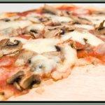Una de nuestras pizzas tan riquisimas! Queso y Champiñones