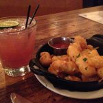 Cheese curds and a signature cocktail