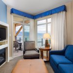 One Bedroom Suite Living Room with Balcony & Lake View