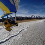 Skimming along the icy beach in a powered hang glider is a great winter activity in Lake Tahoe.