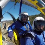 Hang Gliding Tahoe flight instructor and student above Lake Tahoe with Cave Rock in background.