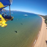Flying powered hang gliders along East Shore Lake Tahoe, Nevada with Hang Gliding Tahoe.