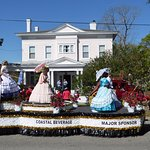 Azalea Festival float passes in front of Rosehill Inn.