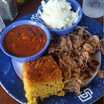 Pulled pork platter with baked beans, mashed potatoes and cornbread. Yum!