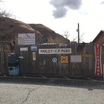 "A fence with old signs at the Hole N"" The Rock site."