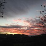 Sunset over the Conwy valley from hotel grounds beyond walled garden