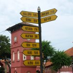 Dutch square and it its central signpost - in case anyone gets lost. Every town should have one