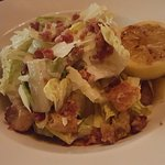 Caesar salad; great salad for a bar. I liked it as it did not have so much of a cream sauce on i