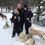 Our musher Tanya in the middle-smiles all around!