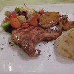Pork Chops grilled in a Dijon barbeque sauce served with grilled mixed vegetables ....