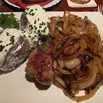 Great steak, smothered with a mess of roasted onions.  Nice, tender baked potatoes to complement