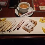 Apple strussel with fresh vanilla cream sauce, garnished with fruit. Espresso, of course.