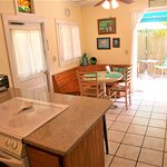 Kitchen with full size appliances leads to private back deck with additional eating table.