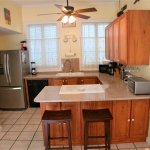 Granite countertops; the cottage is adorned with original local art.
