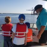 Captain Steve telling the boys about the paper mill.