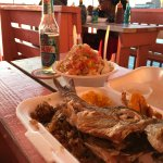 Love the Conch Salad and the fried fish dinner (comes with rice and two sides for $22).