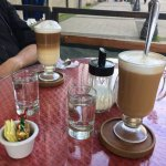 Cafe cortado de mocha blanco, stirred up, and cafe tres leches, not yet stirred.