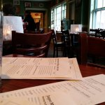 inside the murdock alehouse, sitting at table service.