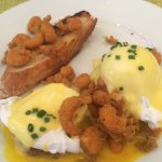 Poached eggs on boudin cakes with crawfish