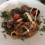 Pasta with muscles, clams and in a tomato and basil sauce
