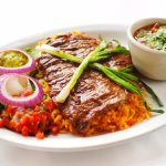 CARNE ASADA Marinated and grilled beef served on a bed of rice along w fresh guacamole, sour cre