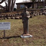 Beautiful Bronze Statues of the Stations of the Cross and Church.