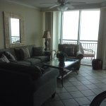 The living room is beautiful and comfortable with an oceanfront view.