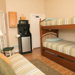 Dorm House: North room with bunkbeds, futon sofa/bed, private full bath. For budget cyclists.