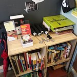 Book and umbrella lending shelf in reception