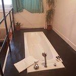 Big deep bath tub - very interesting also