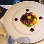 Venison tartar, baby beetroots, horseradish, confit quail egg yolk and a mini rye loaf