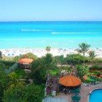 Beach, pool, tiki bar and hotel grounds