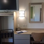 Motel 6 Moab - TV, wall table, chair