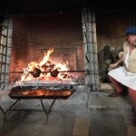 Meat cooking on the spit in the Tudor kitchens
