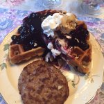 Belgian waffle with homemade blueberry syrup.