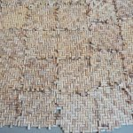 A wall of wine corks ? soundproofing because of opened ceiling?