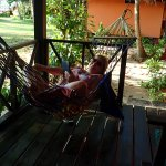 Relaxing in hammock on verandah