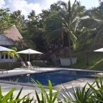 Resort swimming pool, sun beds and parasols, perfect location to enjoy the tropical surroundings