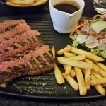 Entrecote with a salad and Belgian fries and a beer sauce