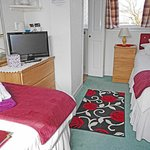 Lovely double aspect Twin room with en-suite shower - can also be a single.