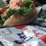 $19.99 Lobster Roll served with potato chips.