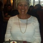The smile says it all. Lemon and Raspberry Posset with Shortbread biscuit and vanilla ice cream.